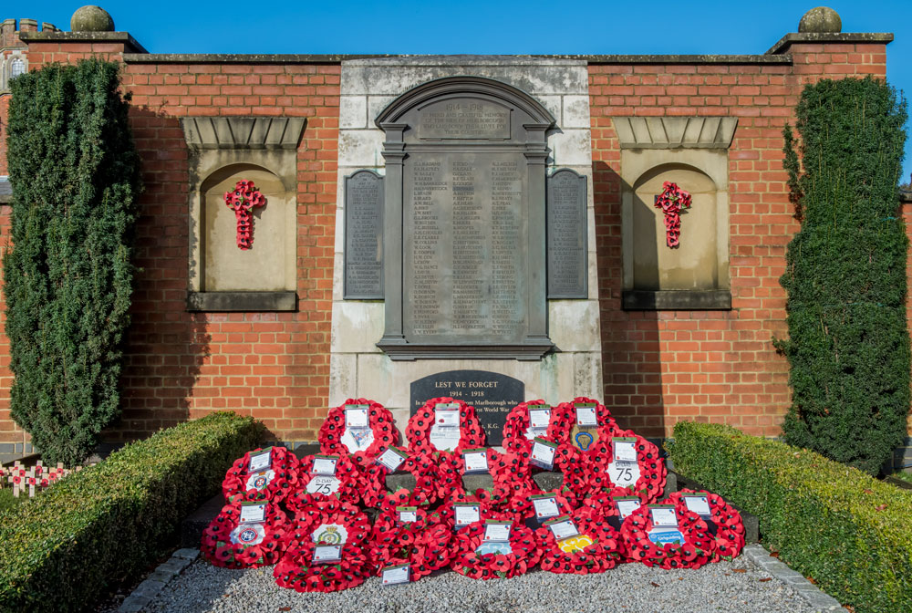 Wreaths laid out in front of the Barn Street War Memorial after this morning's wreath-laying ceremony