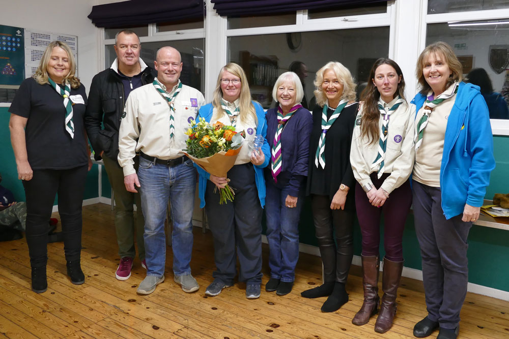 Centre - Alison Barnett holding her gifts.  From left to right Aileen Makin, Derek Baker, Ken McDougall, Alison Barnett, Viv Lucas, Heather Croucher, Jessica Hickson, Belinda Eastland