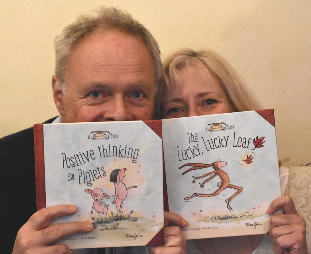 Husband and wife David Hoskins and Chantal Bourgonje with their Horace & Nim books 'The Lucky Lucky Leaf' and 'Positive thinking for Piglets'