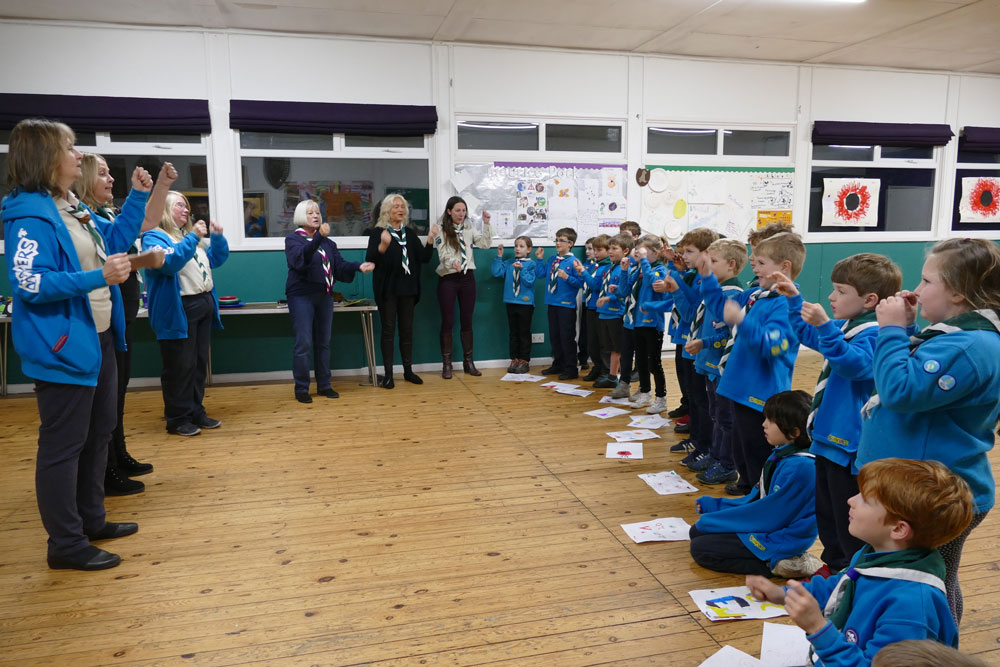 The Beavers and their leaders singing the Beaver song