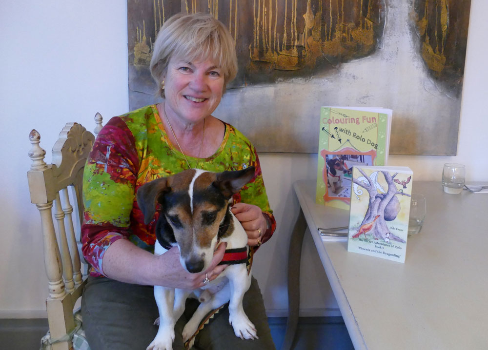 Author Debi Evans with Rolo and her two new books