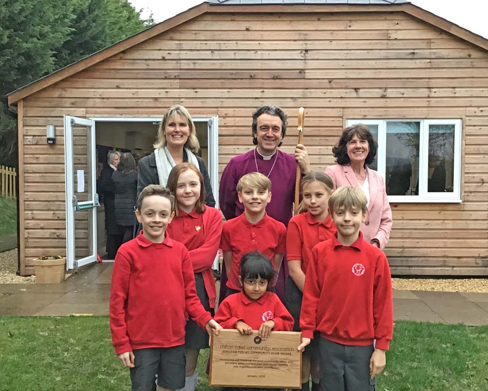 Sam Wolcough, the Bishop of Ramsbury, & Katie Turner, head teacher at Chilton Foliat Primary School - with children from the school