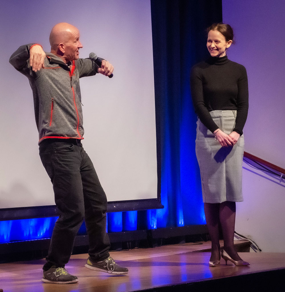 Eddie 'The Eagle' Edwards demonstrating the 'Eddie The Eagle Dance' to Assistant Head Chantal Dean and the audience at Pewsey Vale School