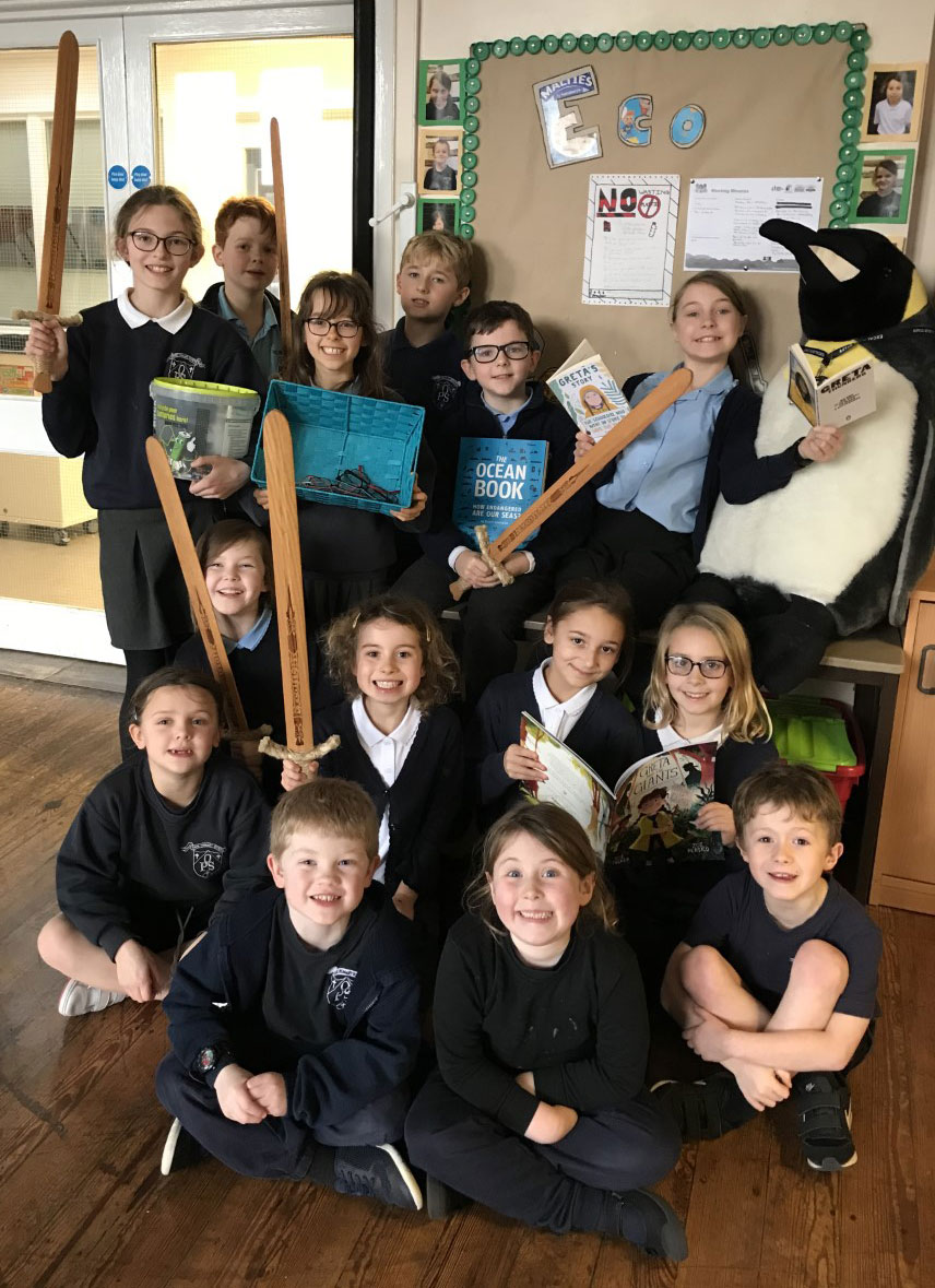 Oare pupils with Excalibur Academies Trust swords and Orlando the penguin