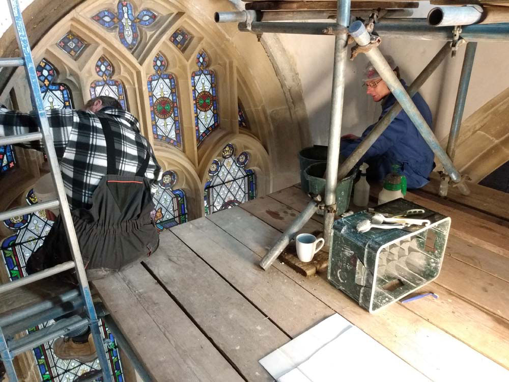 Working from the scaffolding: Howard Chivers & Peter Martindale cleaning stonework