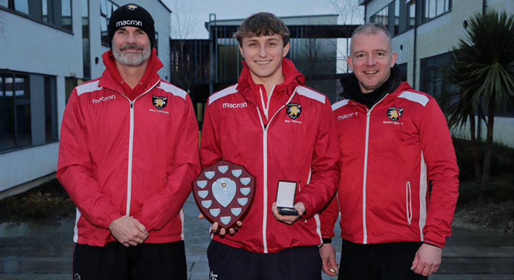 St John's Academy sixth-former and Marlborough RFC rugby coach Max Stevens, flanked by fellow coaches Mike Campbell and Rupert Bound, is the inaugural winner of the 1871 Shield, awarded to the student who makes the most outstanding contribution to rugby at St John's each year