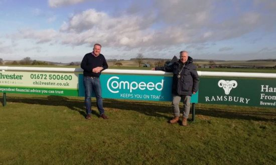 Marlborough Mayor, Mervyn Hall (r) and Rugby Club Secretary, Mark Thomas in front of the newly installed advertising hoardings