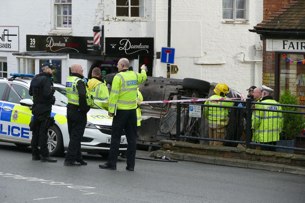 Overturned car blocking Figgins Lane