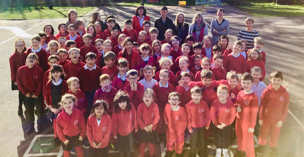 Staff of Chilton Foliat Primary with some pupils celebrating the Ofsted report