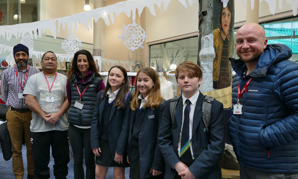 Living Books - l-r: Rav Babbra, Elisi Vunipola, Shelley Rudman, St John's students and Ben Prater with World of Narnia and Snow Queen in the background