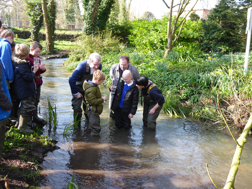 Nearly time to say goodbye!   Danny Kruger MP and Mark Cooper Deputy Mayor inspect the baby trout