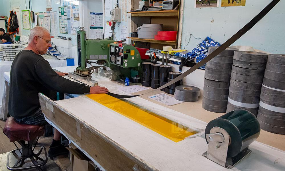 dobie wyatt - Stage 1 of the mask production process at Dobie Wyatt in Cadley - Graham Dobie at the heat sealing machine