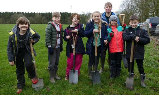 Teacher Kevin Sandall, with St Katharine's pupils making a start on planting the hedge corridor