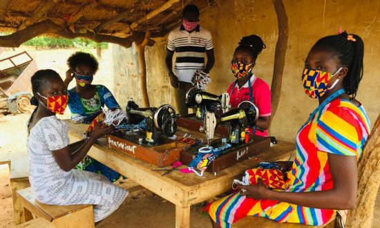 Ramsbury charity Action Through Enterprise (ATE) seamstress Mercy, making masks, supporting the people of Upper West Ghana