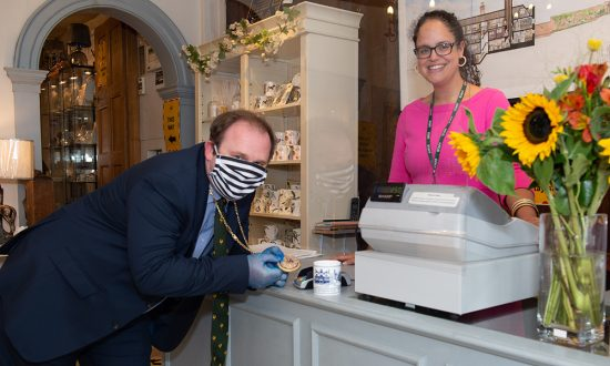 Mayor Mark Cooper sees if the Mayoral Chain works as a contactless payment device when buying one of the Merchant's House Marlborough mugs