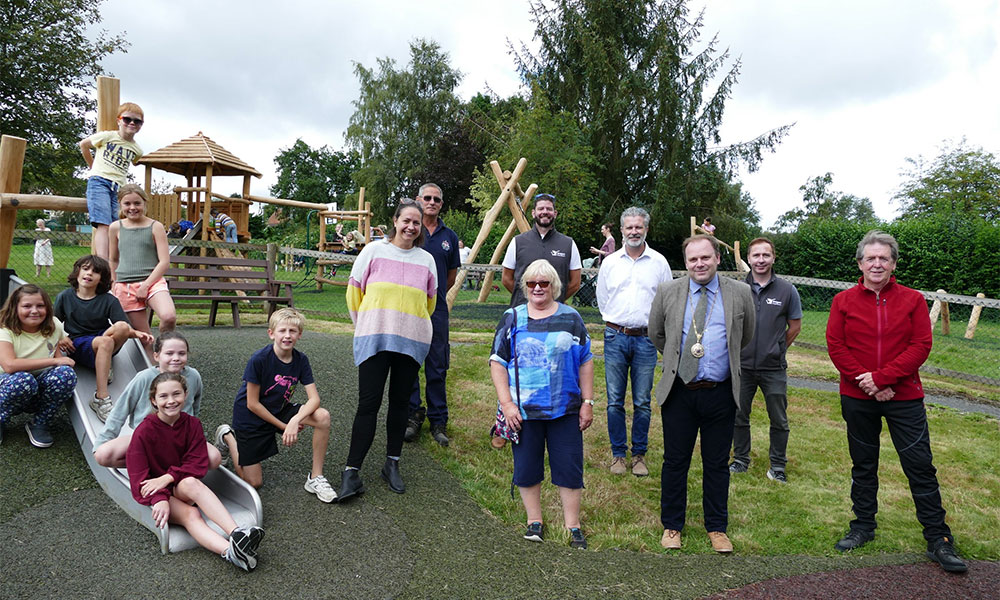 Children and visitors at Manton's Jubilee Field's play and picnic area. L to R – Amy Willsher, Nigel Weatherly, James McGrath, Lindsay Long, Michael Carter, Mayor Mark Cooper, Leon Wilson, Cllr. Don Heath
