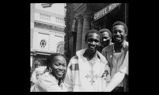 Mankamang Touray (right) with members of the first group to come to Marlborough, standing outside Marlborough Town Hall 1986