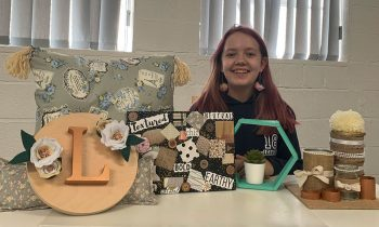 Tish Creative student demonstrates all the craft work she has completed during the trial course run in the school holidays