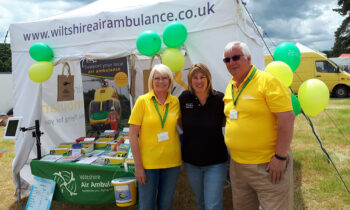 Wiltshire Air Ambulance volunteers Ian (right) and Lorna Best (left) with Wiltshire Air Ambulance pilot Nicky Smith (centre). Photo taken pre-Covid