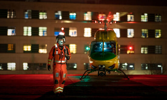 Wiltshire Air Ambulance critical care paramedic Keith Mills alongside the charitys Bell 429 helicopter at Great Western Hospital in Swindon CREDIT Terry Donnelly