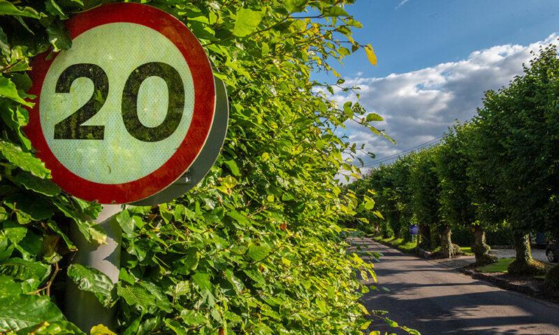 20mph sign in Lockeridge with Kennet Valley School in background