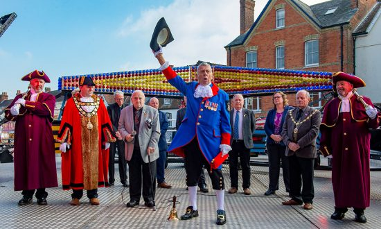 Town Cryer Mike Tupman leads the 'God Save The Queen' as the 2021 Mop Fair is declared open