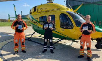 (l-r) Critical care paramedic Richard Miller, pilot Simon Gough and critical care paramedic Craig Wilkins showcase the charity's new Christmas Cards, on sale now for £4 per pack